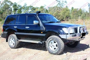 """Right side view of 100 Series Landcruiser fitted with 2"""" inch lift kit with Airbag kit"""