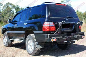 """Rear end view of a Toyota Landcruiser 100 Series IFS fitted with 2"""" inch lift kit with Airbag Man coil helpers"""