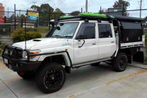 Right side view of a Toyota Landcruiser 79 Series with some AirBag Man Leaf Spring Helpers