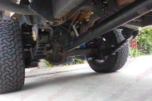 Underside view of a Toyota Landcruiser 79 Series with 2 AirBag Man Leaf Spring Helpers