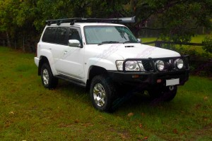 Right side view of a Nissan Patrol GU Wagon fitted with a 2 inch Airbag Man Coil Helper Kit
