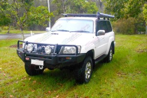 Front view of a white Nissan Patrol GU Wagon fitted with a 2 inch Airbag Man Coil Helper Kit