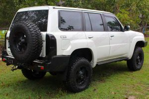 Rear end right view of a white Nissan GU Patrol Wagon fitted with a 3 inch Airbag Man suspension kit