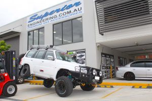 Testing out the rear flex of the GU Nissan Patrol wagon with the forklift at the front of the Superior Engineering 4x4 retail showroom at Deception Bay