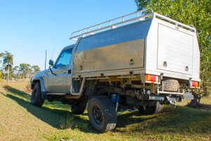 Rear left end flex of a Silver Single Cab 79 Series Toyota Landcruiser fitted with a heavy duty rear coil conversion kit