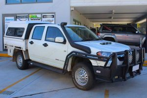 Front right side view of a Holden Colorado (dual cab) fitted with a 40mm Bilstein lift kit and AirBag Man air suspension helper kit
