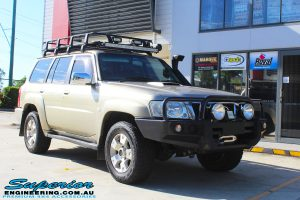 """Right front side view of a Gold Nissan GU Patrol Wagon before fitting a 2"""" inch lift with Dobinsons Coil Springs & Fox Shocks"""