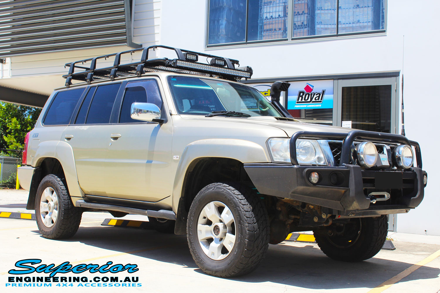 "Right front side view of a Gold Nissan GU Patrol Wagon after fitting a 2"" inch lift with Dobinsons Coil Springs & Fox Shocks"