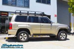 """Side view of a Gold Nissan GU Patrol Wagon after fitting a 2"""" inch lift with Dobinsons Coil Springs & Fox Shocks"""