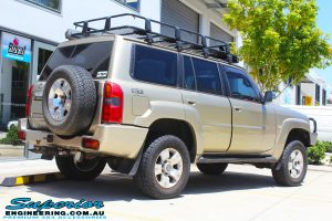 """Back right view of a Gold Nissan GU Patrol Wagon after fitting a 2"""" inch lift with Dobinsons Coil Springs & Fox Shocks Kit"""