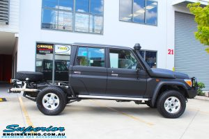 """Right side view of a Black Toyota 79 Series Landcruiser Dual Cab before fitting a Superior Remote Reservoir 2"""" Inch Lift Kit with Airbag Man Leaf Air Kit"""