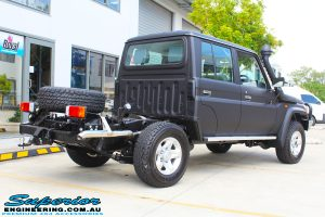 """Rear right view of a Black Toyota 79 Series Landcruiser Dual Cab before fitting a Superior Remote Reservoir 2"""" Inch Lift Kit with Airbag Man Leaf Air Kit"""