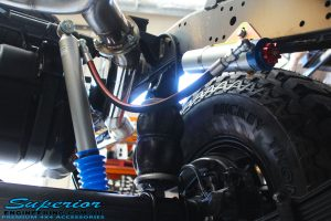 Rear left underbody view of the Superior Remote Reservoir Shock & Airbag Man Leaf Air Kit