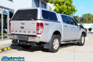 "Rear right view of a Silver Ford PX Ranger before fitment of a Bilstein 2"" Inch Lift Kit + Airbag Man Leaf Air Kit"