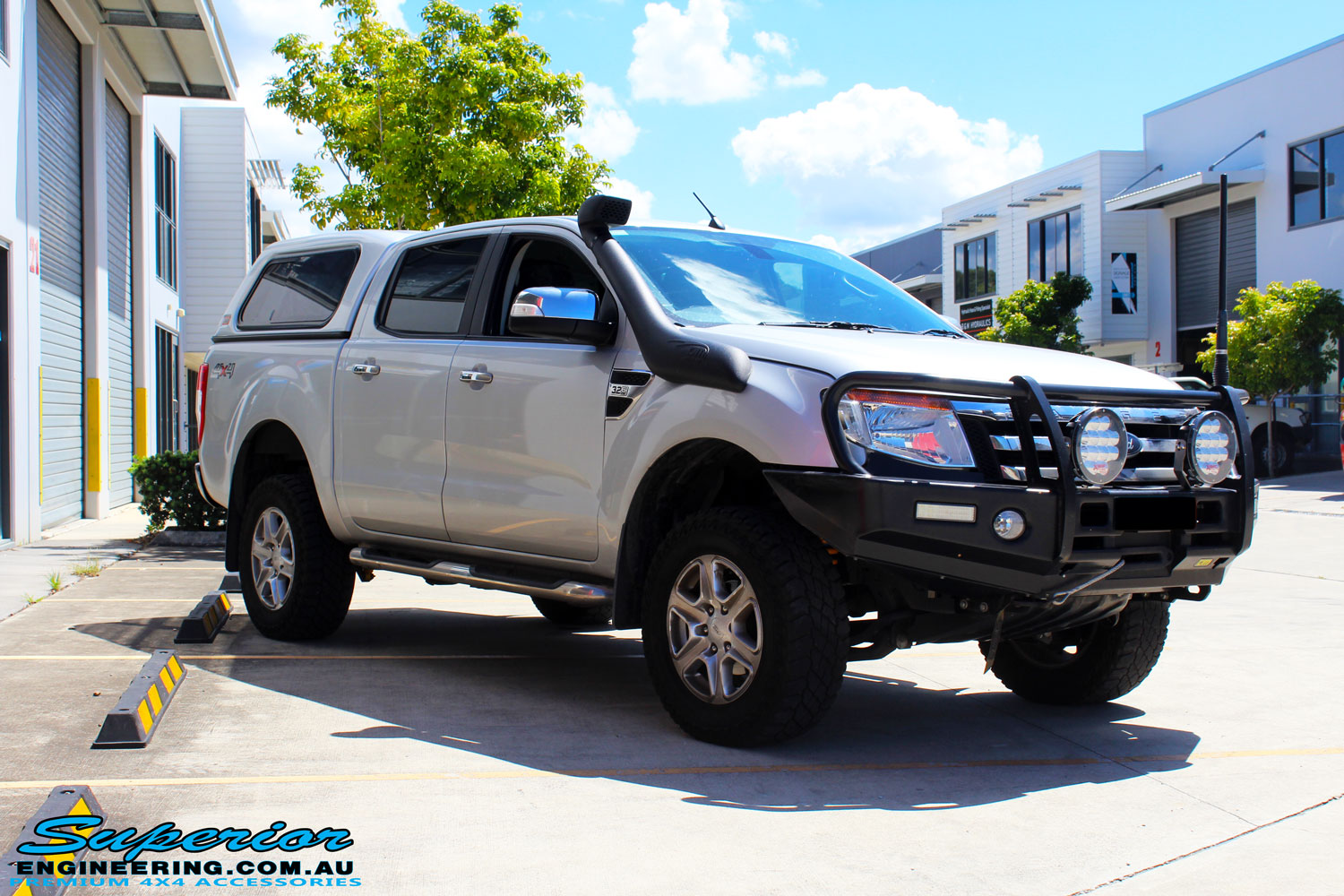 "Left front side view of a Silver Ford PX Ranger after fitment of a Bilstein 2"" Inch Lift Kit + Airbag Man Leaf Air Kit"