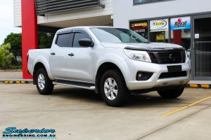 "Right front side view of a Grey Nissan NP300 Navara Ute before fitment of a Superior Nitro Gas 4"" Inch Lift Kit + Airbag Man 2"" Coil Air Kit Helper, Ironman 4x4 Flomax Air Compressor and Nitto Trail Grappler Tyres with King Gator Wheels"
