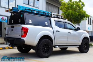"""Rear right view of a Grey Nissan NP300 Navara Ute after fitment of a Superior Nitro Gas 4"""" Inch Lift Kit + Airbag Man 2"""" Coil Air Kit Helper, Ironman 4x4 Flomax Air Compressor and Nitto Trail Grappler Tyres with King Gator Wheels"""