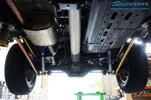 Rear underbody view of fitted Superior Nitro Gas Shocks + Coil Springs with Airbag Man Coil Air Kit Helper and Lower & Upper Control Arms