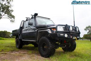 """Front right side view of a Grey Toyota 79 Series Landcruiser Dual Cab before fitment of a Superior 4"""" Inch Rear Coil Conversion Kit with Hyperflex Radius Arms, Remote Reservoir Shocks and a Airbag Man 4"""" Inch Coil Helper Air Kit."""