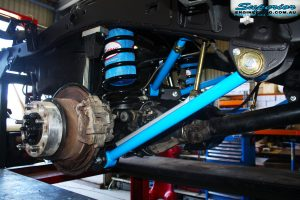 Front view of the right hub assembly after fitment showing Remote Reservoir Shock, Coil Spring with Airbag Man Coil Helper and Lower & Upper Control Arms.