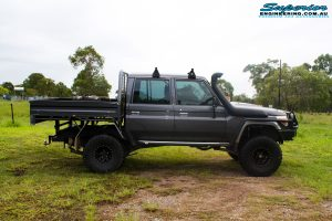 "Right side view of a Grey Toyota 79 Series Landcruiser Dual Cab before fitment of a Superior 4"" Inch Rear Coil Conversion Kit with Hyperflex Radius Arms, Remote Reservoir Shocks and a Airbag Man 4"" Inch Coil Helper Air Kit."