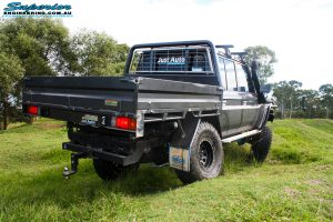 """Rear right side view whilst flexing of a Grey Toyota 79 Series Landcruiser Dual Cab after fitment of a Superior 4"""" Inch Rear Coil Conversion Kit."""