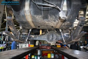 Rear underbody view before fitment of 79 series coil conversion gear.