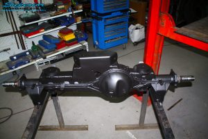Rear axle housing after fitment of bottom shock, control arm mounts and spring perches also removal of tabs.
