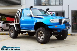 """Right front side view of a Blue Toyota 80 Series Landcruiser Ute Chop before fitment of a Airbag Man 4"""" Inch Coil Air Helper Kit"""