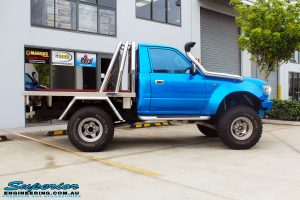 "Side view of a Blue Toyota 80 Series Landcruiser Ute Chop before fitment of a Airbag Man 4"" Inch Coil Air Helper Kit"