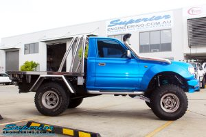 """Side view of a Blue Toyota 80 Series Landcruiser Ute Chop after fitment of a Airbag Man 4"""" Inch Coil Air Helper Kit"""