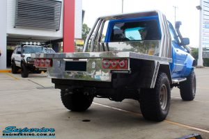 """Rear right view of a Blue Toyota 80 Series Landcruiser Ute Chop after fitment of a Airbag Man 4"""" Inch Coil Air Helper Kit"""