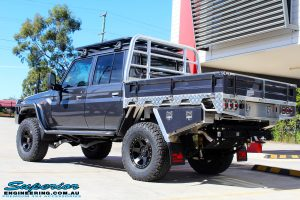 """Rear left side view of a Grey Toyota 79 Series Landcruiser Dual Cab after fitment of a Superior 3"""" Inch Nitro Gas Lift Kit, Airbag Man Digital Dual Air Control Kit w/Tyre Inflation & Leaf 3"""" Inch Air Lift Kit"""