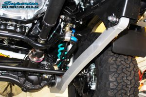 Underbody front right view of the fitted Superior Radius Arm, Swaybar Extensions, Coil Springs & Nitro Gas Shocks