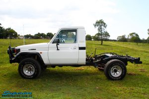 """Left side view of a Toyota Landcruiser 79 Series after fitting a Superior 2"""" Inch Rear Coil Conversion Kit"""
