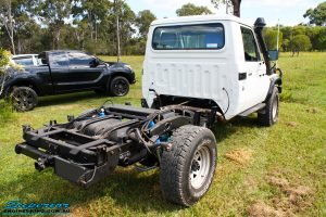 """Rear right view of a Toyota Landcruiser 79 Series after fitting a Superior 2"""" Inch Rear Coil Conversion Kit"""