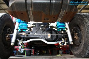 """Rear underbody view of the fitted fitted Superior 2"""" Inch Nitro Gas Shock Absorbers, Coil Springs with Airbag Man Coil Air Kit and Sway Bar Kit"""