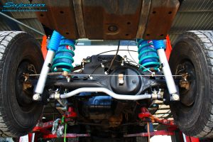 "Rear underbody view looking forward on the fitted Superior 2"" Inch Rear Coil Conversion Kit"