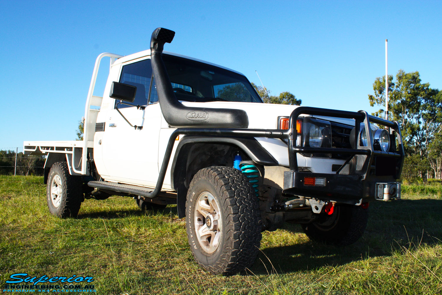 """Right front side view of a Toyota Landcruiser 79 Series after fitting a Superior Coil Conversion 2"""" Inch Stage 4 Full Front & Rear Kit + Airbag Man Coil Air Kit Helper, Superior Steering Damper, Tie Rod, Heavy Tow Points & Solid Drag Link Bar"""