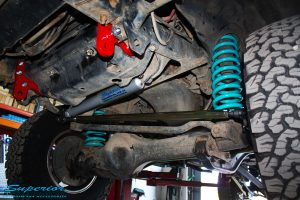 Front underbody view of the fitted Superior Heavy Duty Tow Points, Drag Link Bar, Coil Springs + Steering Damper