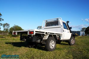 """Rear underbody right view of a Toyota Landcruiser 79 Series after fitting a Superior Coil Conversion 2"""" Inch Stage 4 Full Front & Rear Kit + Airbag Man Coil Air Kit Helper, Superior Steering Damper, Tie Rod, Heavy Tow Points & Solid Drag Link Bar"""