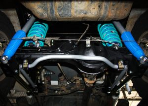 "Mid rear looking up of the fitted Superior Coil Conversion 2"" Inch Rear Kit containing Remote Reservoir Shocks, Coil Springs, Swar Bar Kit, Lower Control Arms + Airbag Man Coil Air Kit Helper"