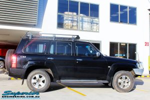 """Right side view of a Black Nissan GU Patrol Wagon being fitted with a Superior 2"""" Inch Nitro Gas Lift Kit, Airbag Man 2"""" Inch Coil Air Helper Kit, Safari Snorkel, Brown Davis Long Range Fuel Tank, Superior Coil Tower Brace Kit & Superior Upper Control Arms"""