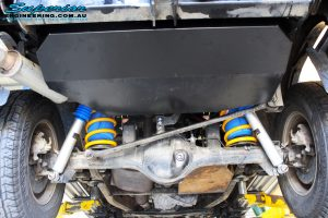 """Rear underbody view of the fitted Brown Davis Long Range Fuel Tank, Airbag Man 2"""" Inch Coil Air Helper, Rear Superior Nitro Gas Shocks & King Springs"""