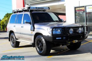 """Right front side view of a Silver Toyota 100 Series Landcruiser before fitment of a 2"""" Inch Lift Kit with Airbags"""