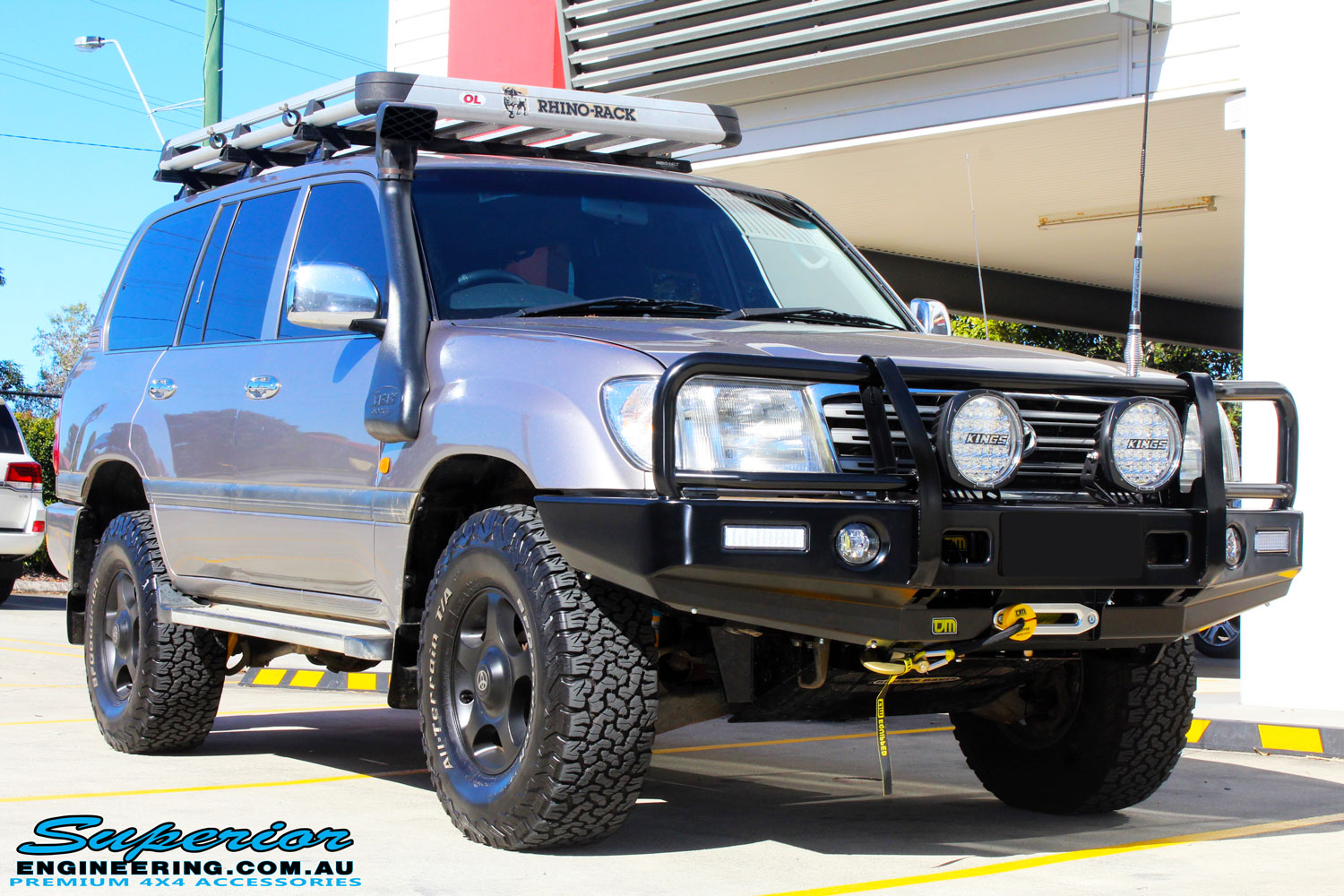 "Right front side view of a Silver Toyota 100 Series Landcruiser after fitment of a 2"" Inch Lift Kit with Airbags"