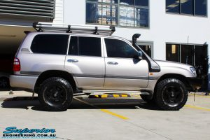 """Right side view of a Silver Toyota 100 Series Landcruiser after fitment of a 2"""" Inch Lift Kit with Airbags"""
