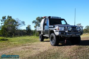 """Right front side view of a Toyota Landcruiser 79 Series after fitting a Superior 2"""" Inch Coil Conversion Fully Fitted Kit + Airbag Man Coil Helper Air Kit & Superior Swaybar Extensions"""