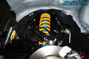 Front right inside guard view of the fitted Superior Remote Reservoir Struts + Coil Spring