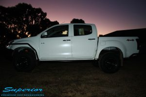 """Right side view of a White Isuzu D-Max Dual Cab after being fitted with a Superior Remote Reservoir 2"""" Inch Lift Kit, Airbag Man Leaf Air Kit, Ironman 4x4 Bullbar + Side Steps, VRS Winch, Safari Snorkel + King Wheels & Nitto Tyres"""